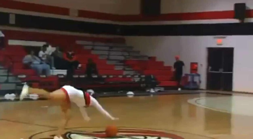 Cheerleader Hits Amazing Basketball Trick Shot