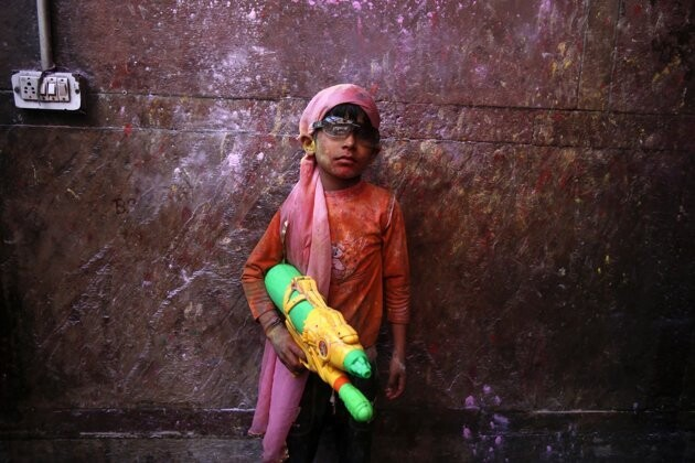 Indian Boy With Squirt Gun