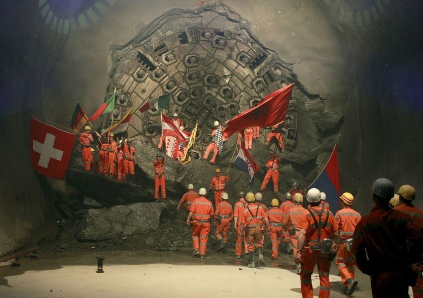 Miners celebrate after a giant drill machine broke through the rock at the final section