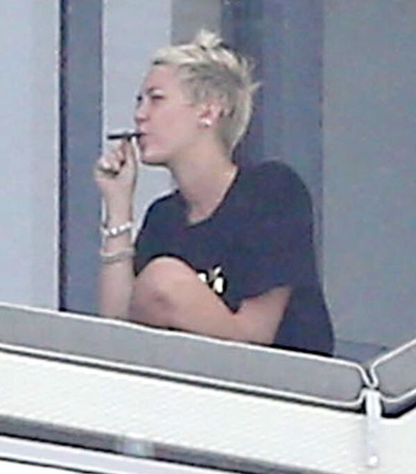 Miley Cyrus is smoking a suspicious cigarette