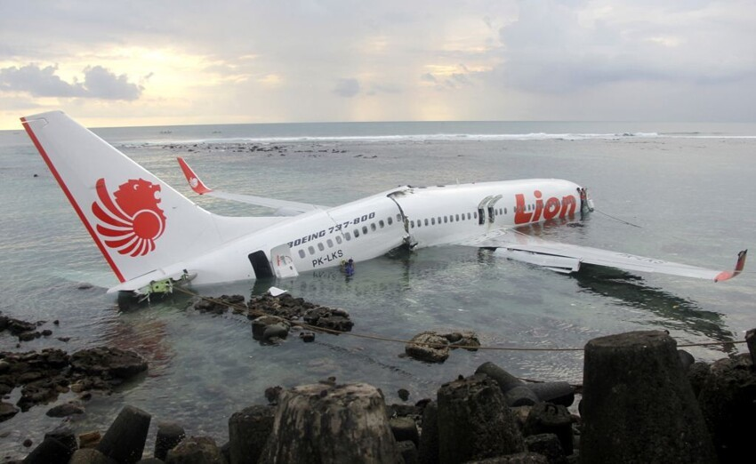rescuers stand near the wreckage of a crashed Lion Air plane in Bali