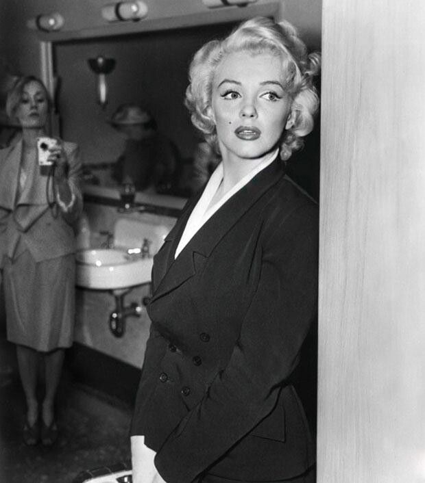 Borsi sneaking a shot of Marilyn Monroe from inside a bathroom
