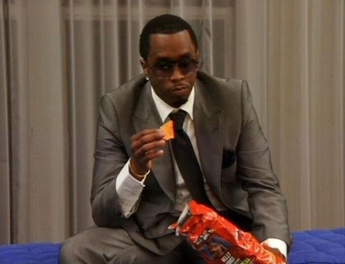 Diddy enjoying a single dorito: