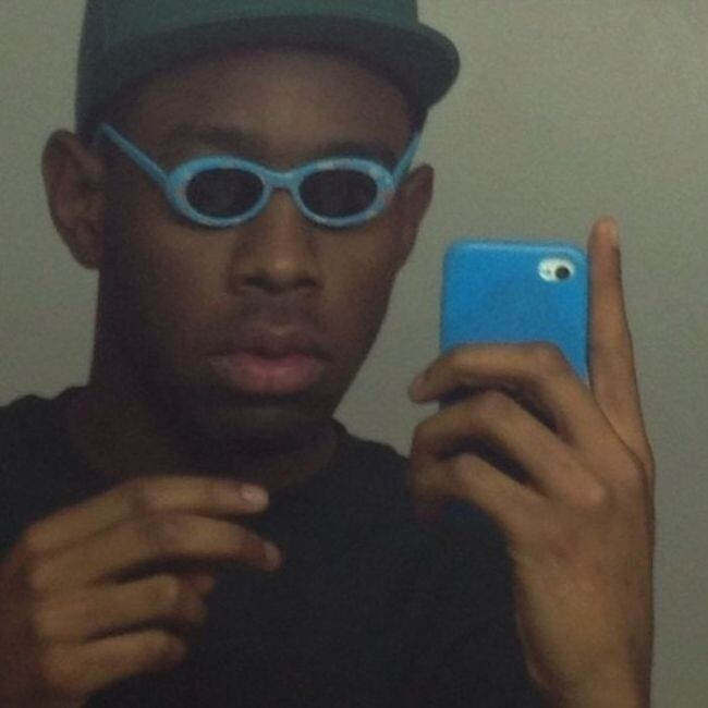 Tyler, The Creator right after stealing a baby's sunglasses:
