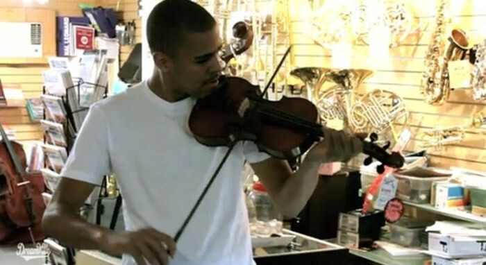J. Cole attempting to fire a violin bow like an arrow:
