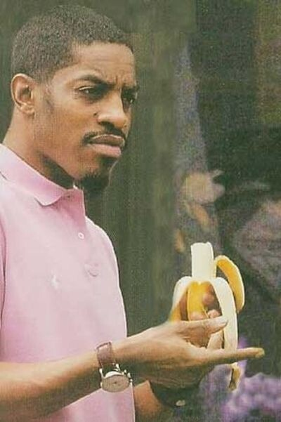 Andre 3000 realizing that he mistook the banana he's eating for a grapefruit: