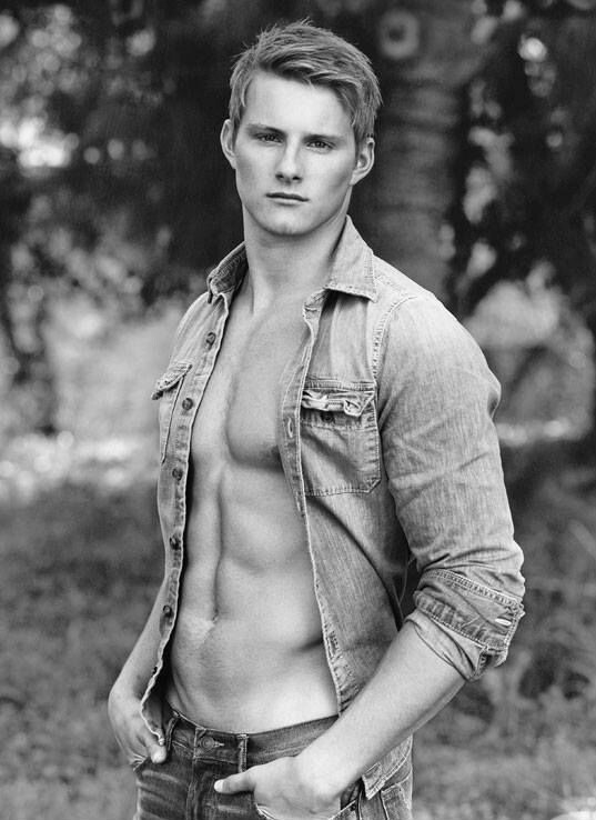 'Hunger Games' Hottie Alexander Ludwig Poses Shirtless with a Puppy