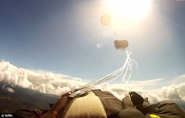 A skydiver is nearly hit by a falling METEORITE