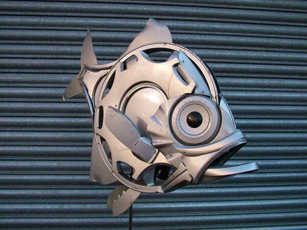 What This Guy Does With Hubcaps And Other Junk By The Road Is BRILLIAN