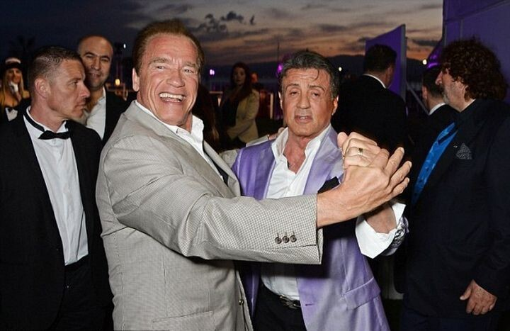 Schwarzenegger And Stallone Share A Dance
