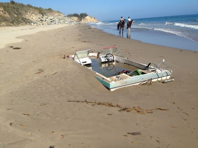 A Surprisingly Big Boat Found Buried on the Beach