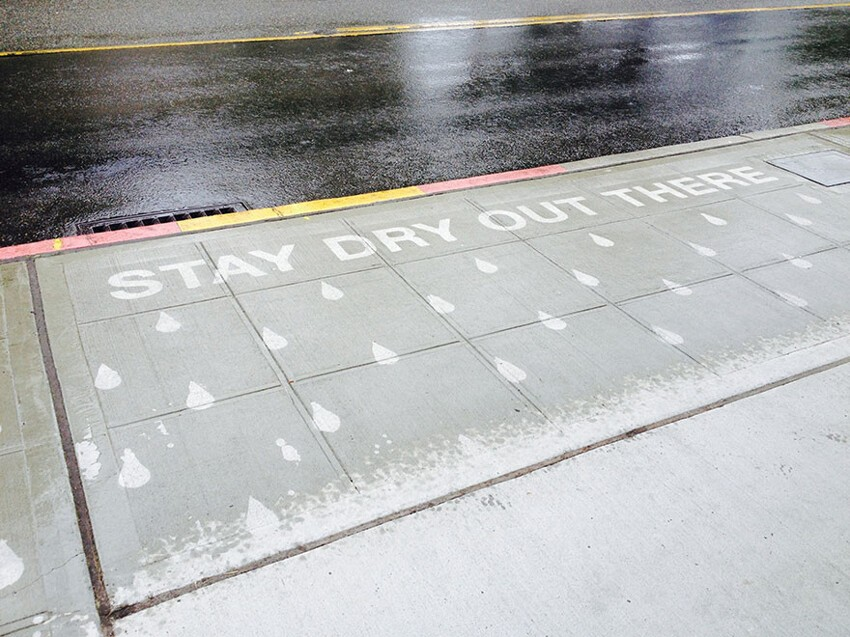 Artist Creates Street Art To Make People Smile On A Rainy Day