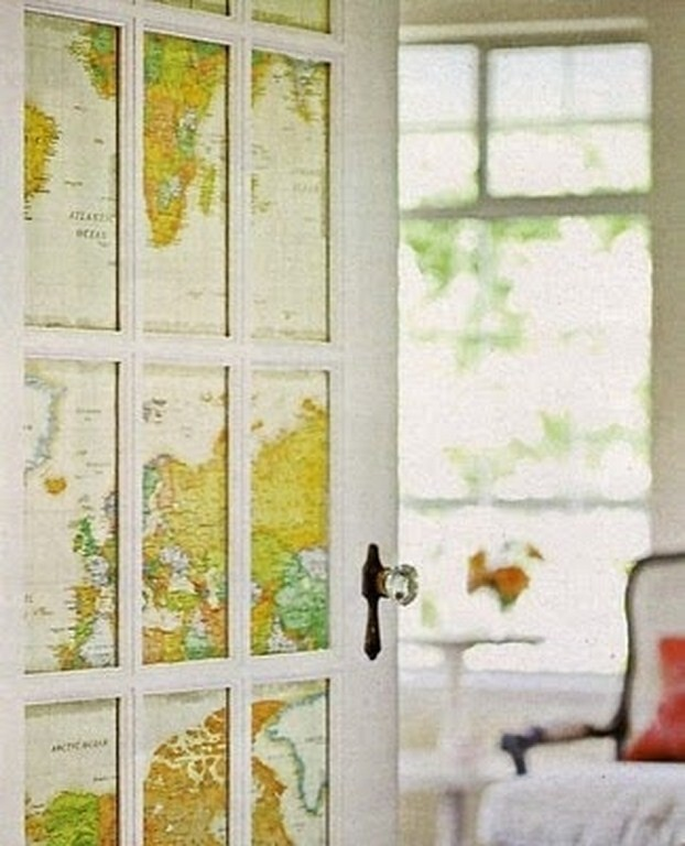 Instead of putting blinds over french doors, attach old maps to the panes for privacy.