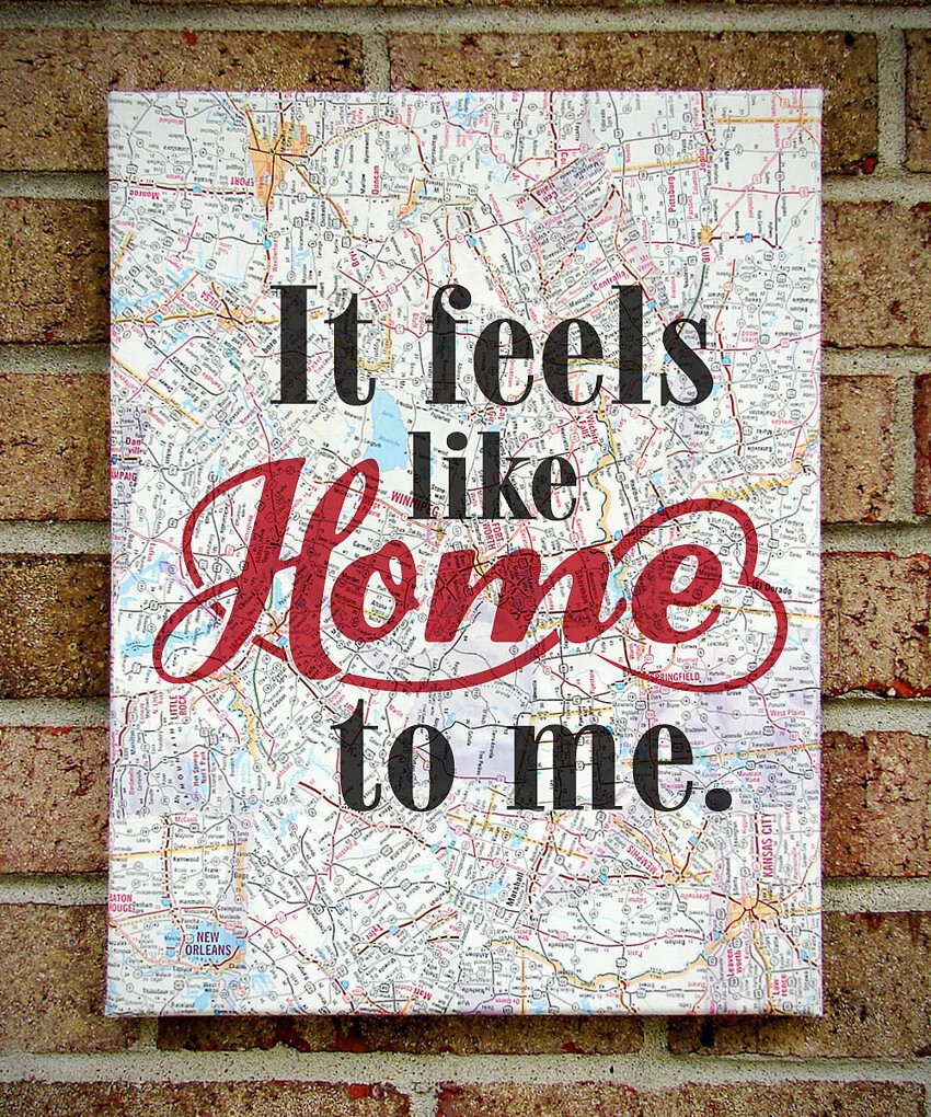Paint or attach sticker letters to a canvas decoupaged with a map.