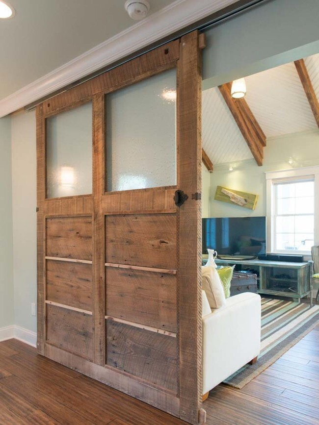 If you have some serious DIY skills under your belt, you can make this reclaimed wood sliding door.