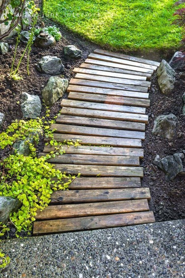 Wood planks become a cute garden pathway, no sanding required.