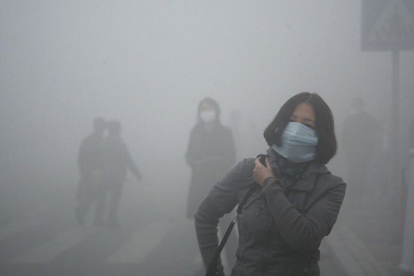 Girl Walks Through Smog In Beijing