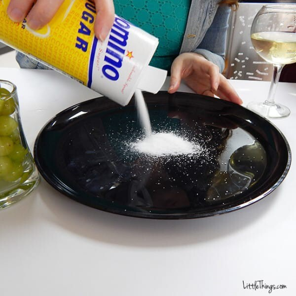 Pour 1/4 cup of sugar onto a plate.