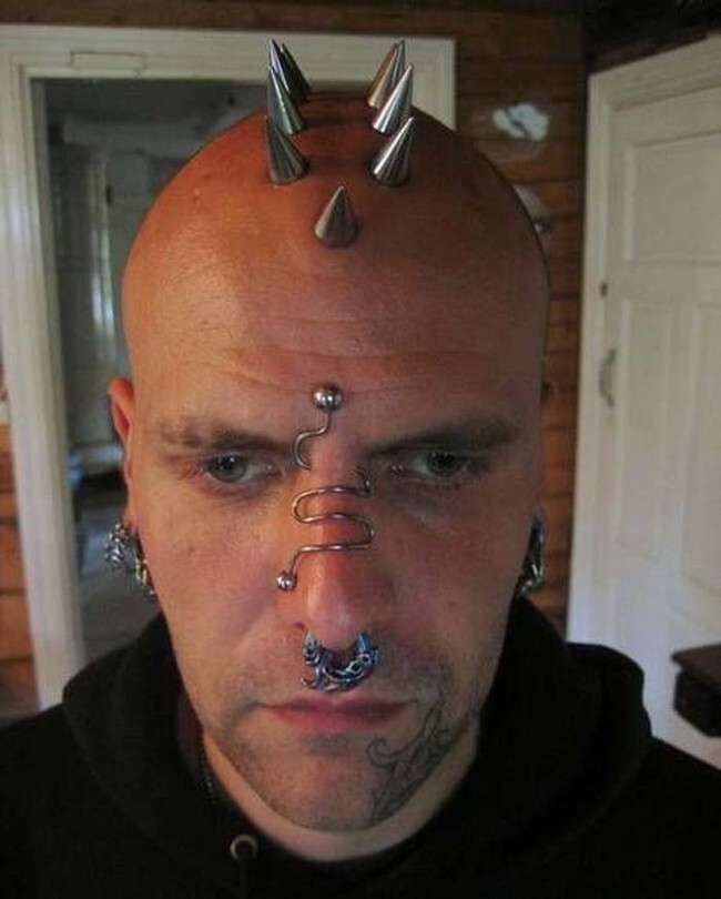 Those are some nice cranial piercings. They probably get pretty cold in the winter.