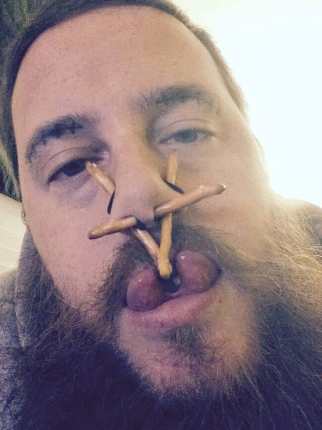 I'm pretty sure those are pretzels inside his nose piercings.
