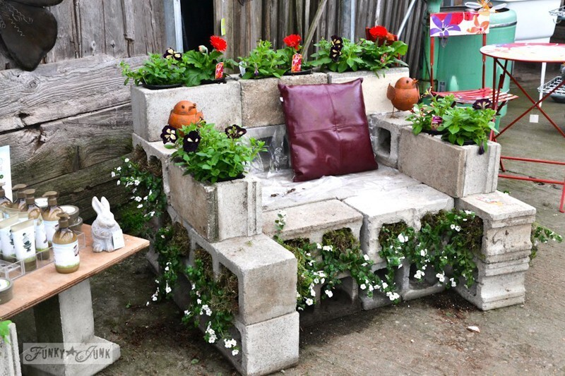 9. Create a cinder block chair, and throw a ton of cushions on it.