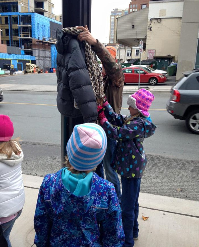 Tara Smith-Atkins' daughter and her friends hung winter coats on street poles for the homeless to take