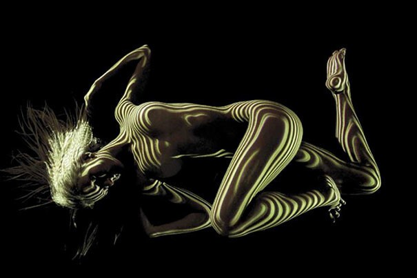 Photographer Dresses Nude Women In Light And Shadows