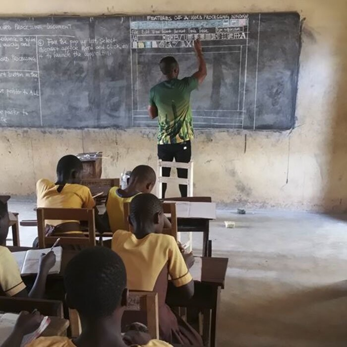 Owura Kwadwo from Kumasi, Ghana, has to improvise when teaching ICT to kids without access to computers
