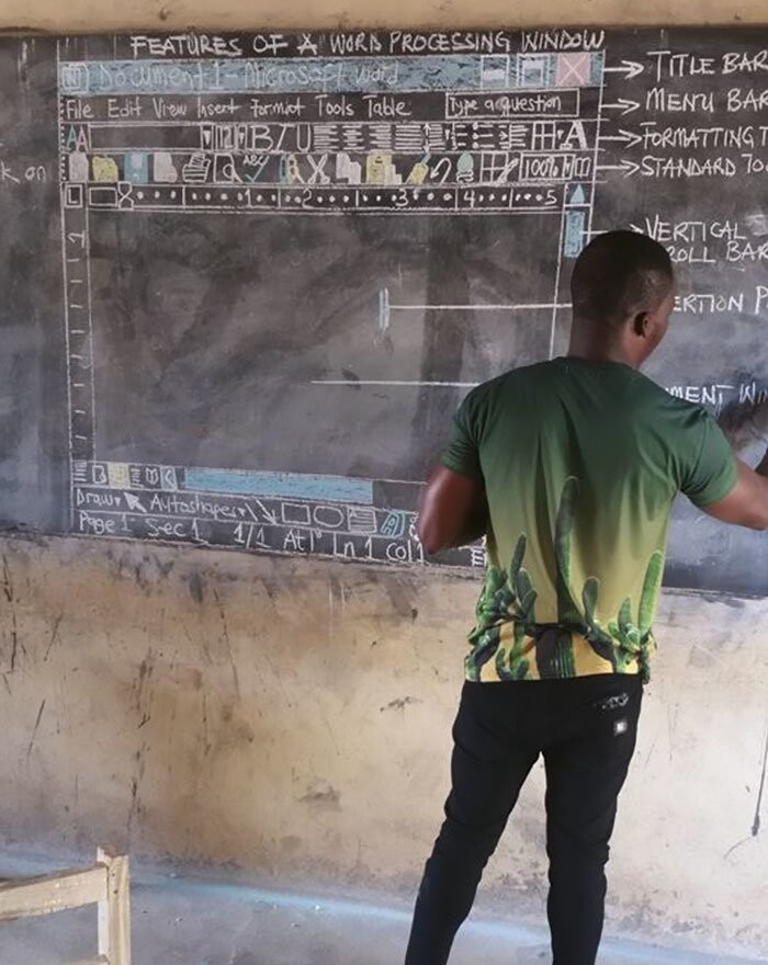 When teaching Microsoft Word, he draws a complete screenshot on the chalkboard for his students to copy and learn from
