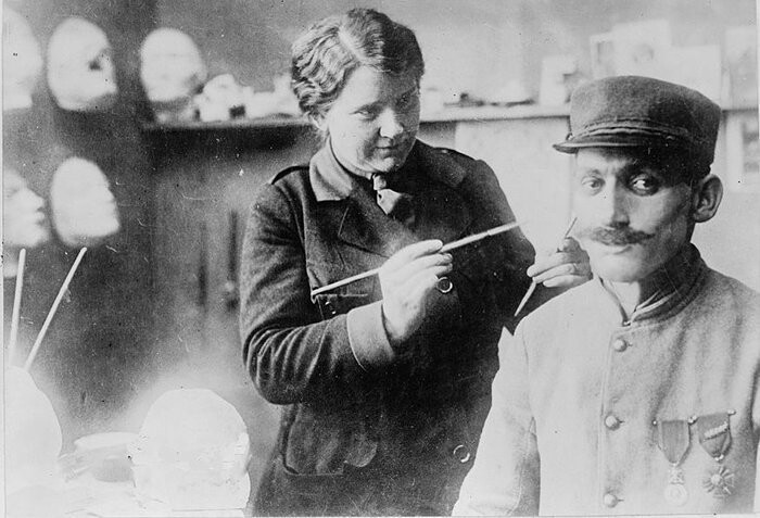"In late 1917, Ladd was inspired by sculptor Francis Derwent Wood who created face masks for severely injured WWI warriors in his ""Tin Noses Shop"""