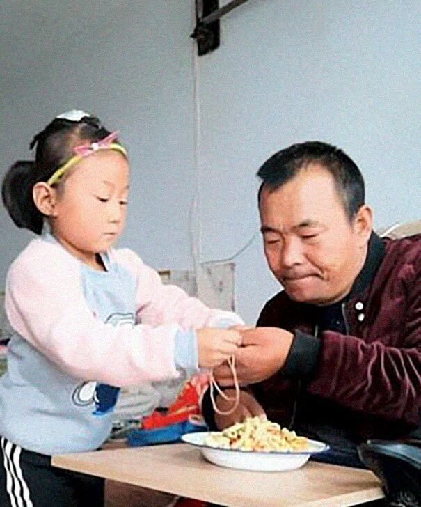 6-year-old Jia Jia has been helping her father to get about his daily life for 2 years now