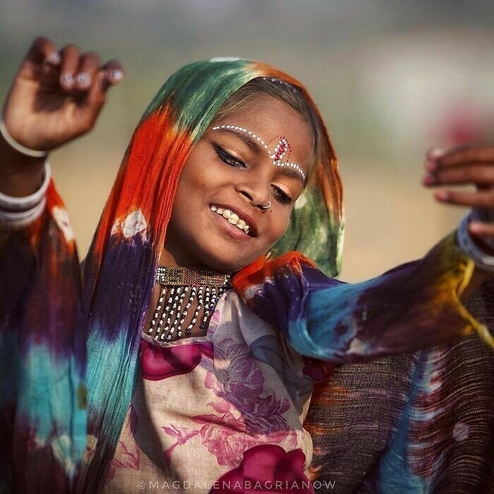 """FORGET YOUR TROUBLES AND DANCE"" - Bob Marley. Sagina, beautiful girl from Kalbelia caste dancing at the Pushkar Fair grounds"