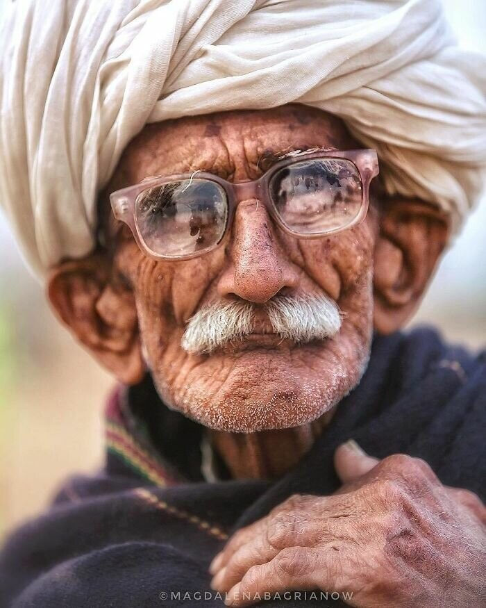 Portrait of an old Rajasthani herder taken on the cold morning at the camel fair