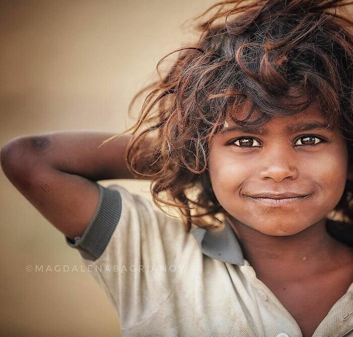 Portrait of a cute gypsy boy, taken at the Pushkar fair grounds
