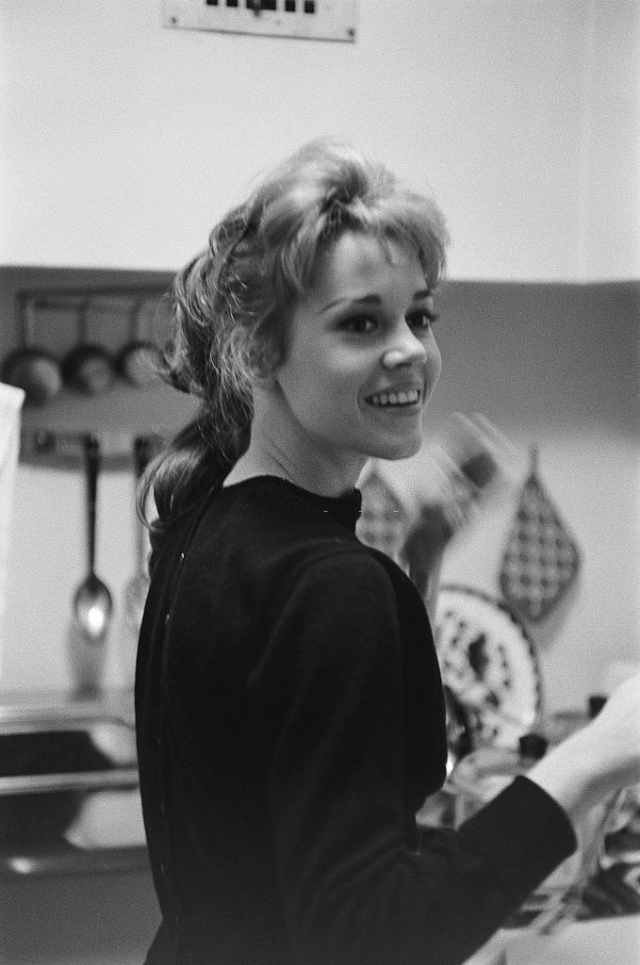 Jane Fonda smiling in her kitchen.