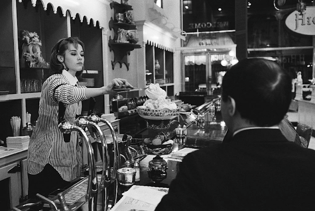 Jane Fonda preparing a cup of ice-cream for a client at Hicks & Son.