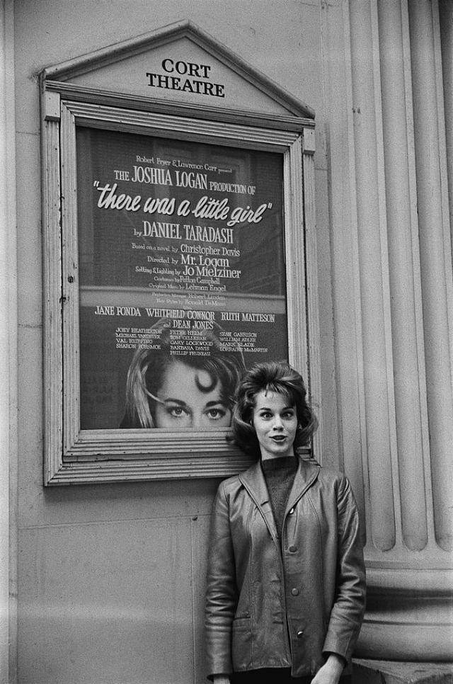 Jane Fonda posing in front of the poster of her play at the Cort Theatre.
