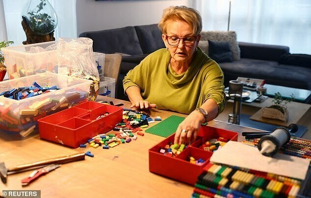 Ebel building a wheelchair ramp from donated Lego bricks in the living room of her flat in Hanau on Monday